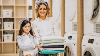 mother and daughter doing laundromat business self service